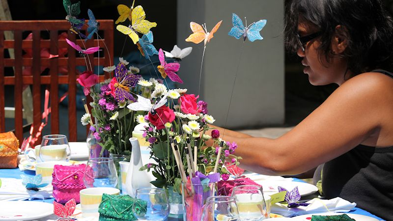Anik Making Butterfly Table Decorations